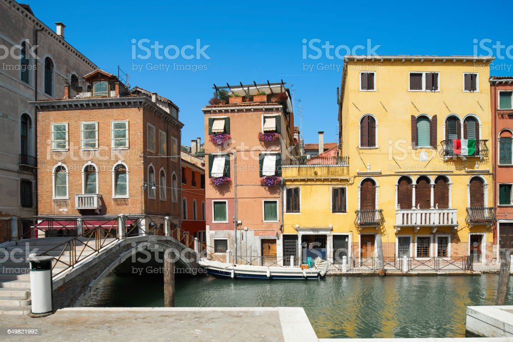 Old houses and bridge over Canal De Cannaregio in Venice stock photo