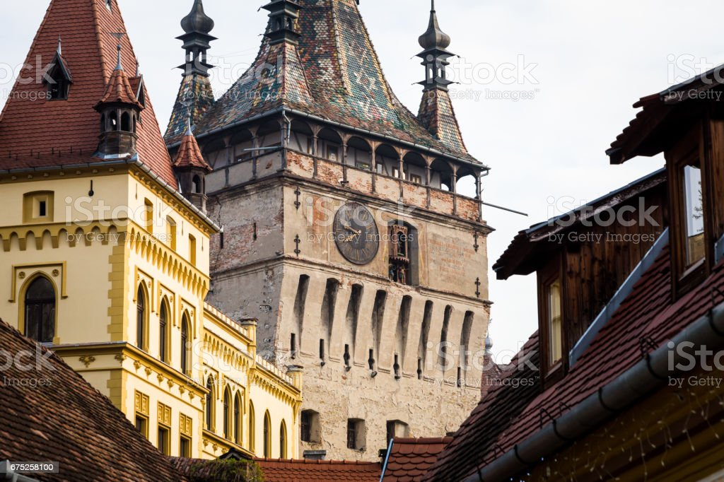 Old houses and clock tower in Sighisoara old town, Transylvania, Romania stock photo