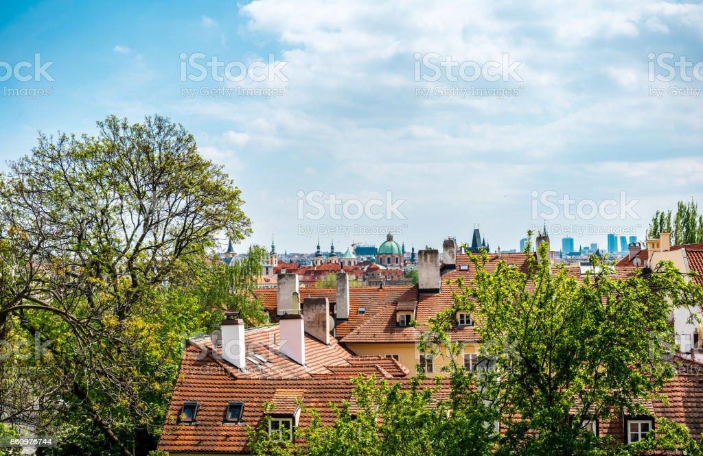 Old houses and old tiled roofs of Prague. Aerial view stock photo