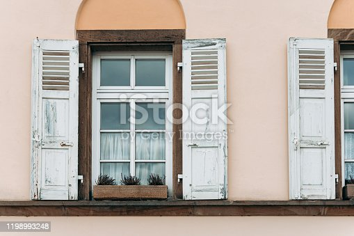 istock old houses facade with windows and folding shutters 1198993248
