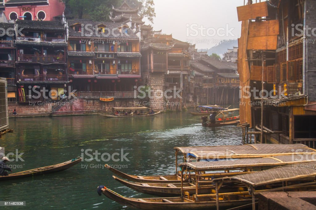 Old houses in Fenghuang county on Oct 22, 2013 in Hunan, China. The ancient town of Fenghuang was added to the UNESCO World Heritage Tentative List in the Cultural category. stock photo