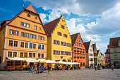 istock Old houses in Rothenburg ob der Tauber, picturesque medieval city in Germany, famous UNESCO world culture heritage site, popular travel destination 1035127060