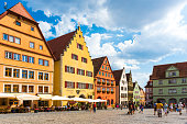 istock Old houses in Rothenburg ob der Tauber, picturesque medieval city in Germany, famous UNESCO world culture heritage site, popular travel destination 1203206911