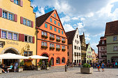 istock Old houses in Rothenburg ob der Tauber, picturesque medieval city in Germany, famous UNESCO world culture heritage site, popular travel destination 1207082663