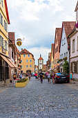 istock Old houses in Rothenburg ob der Tauber, picturesque medieval city in Germany, famous UNESCO world culture heritage site, popular travel destination 1211631222