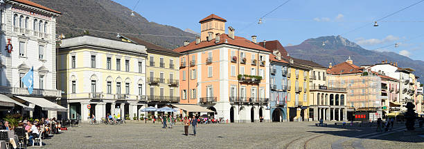 Old houses Piazza grande square at Locarno Locano, Switzerland- October 19, 2014: tourists walking and sitting in the middle of old houses on Piazza grande square at Locarno on the italian part of Switzerland piazza grande stock pictures, royalty-free photos & images