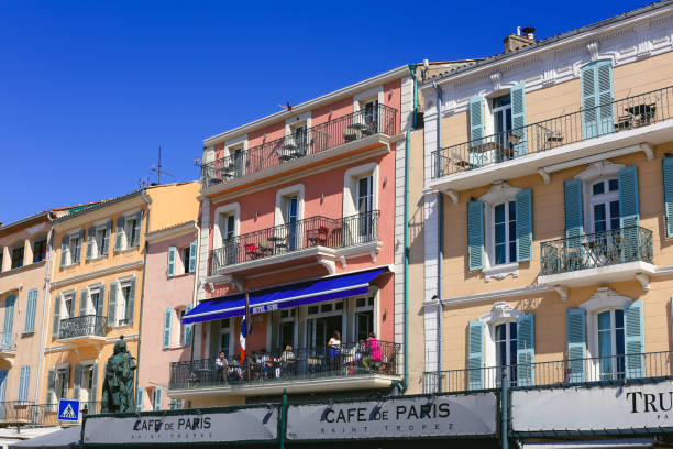 Old Houses with Orange and Yellow Facades, St.Tropez, France St Tropez, France - August 31, 2018: Old houses with orange and yellow facades and Cafe bars at St Tropez. var stock pictures, royalty-free photos & images