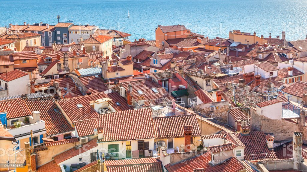 Old houses with red roofs in Piran town on Adriatic sea. royalty-free stock photo