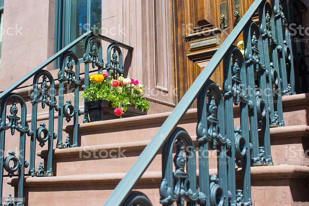 Old houses with stairs in historic district of West Village stock photo