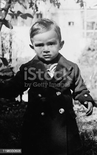 Black and white Old image of a hispanic little boy taken in 1939