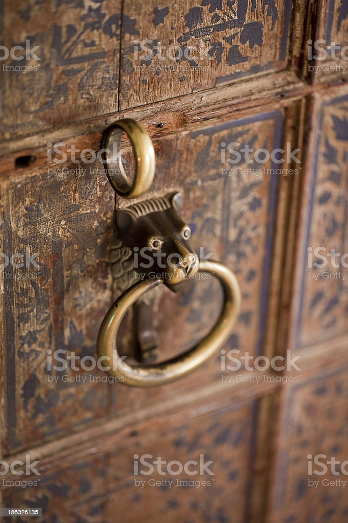 Old Indian door handle shaped as lion / dog royalty-free stock photo