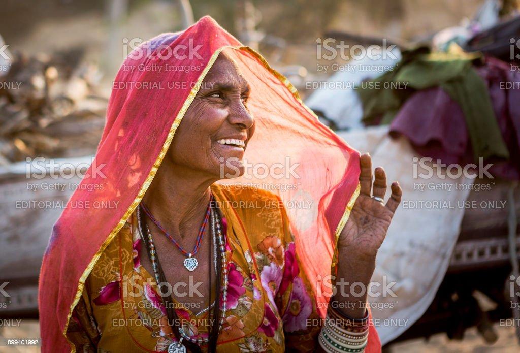 old indian lady in pushkar fair stock photo