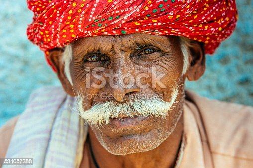 Portrait of an old Indian man looking at the camera, shot in the little village of Sabalpura in Rajasthan, India.
