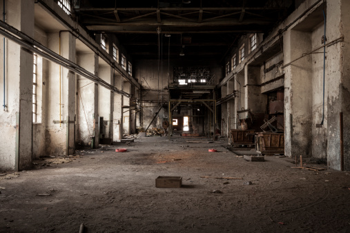 Old abandoned industrial building. Legacy of the main hall in foundry factory.
