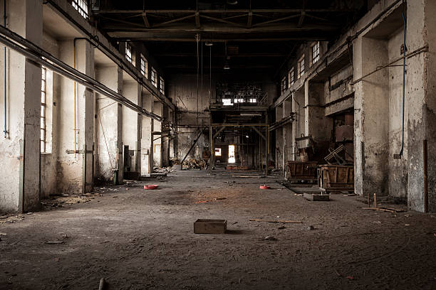 Old industrial building Old abandoned industrial building. Legacy of the main hall in foundry factory. warehouse interior stock pictures, royalty-free photos & images