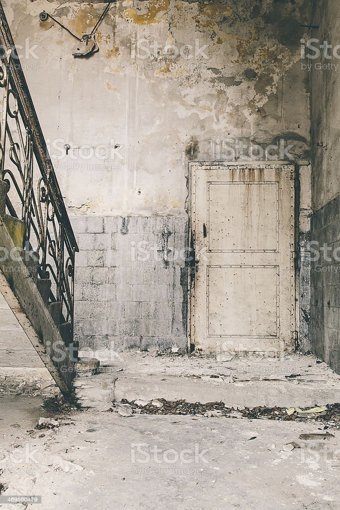 Old industrial door in a warehouse royalty-free stock photo