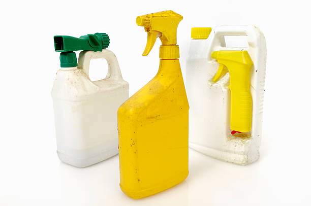 Old insecticide or pesticide containers Old insecticide or pesticide containers.  Hazardous household chemicals requiring safe disposal. herbicide stock pictures, royalty-free photos & images