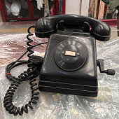 Vintage black intercom phone for sale at Palermo's flea market. In this place anything is for sale as long as it is second hand, even if it is broken or useless