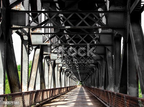 826748544 istock photo Old iron and steel bridge 700571152