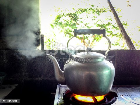 An old iron kettle on the fire