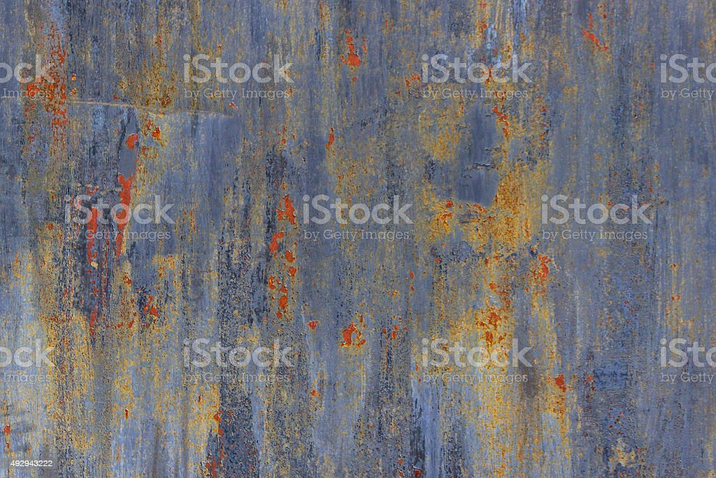 old  iron multi-colored wall stock photo
