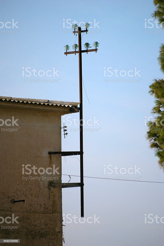 old iron pole wall to transport electricity stock photo
