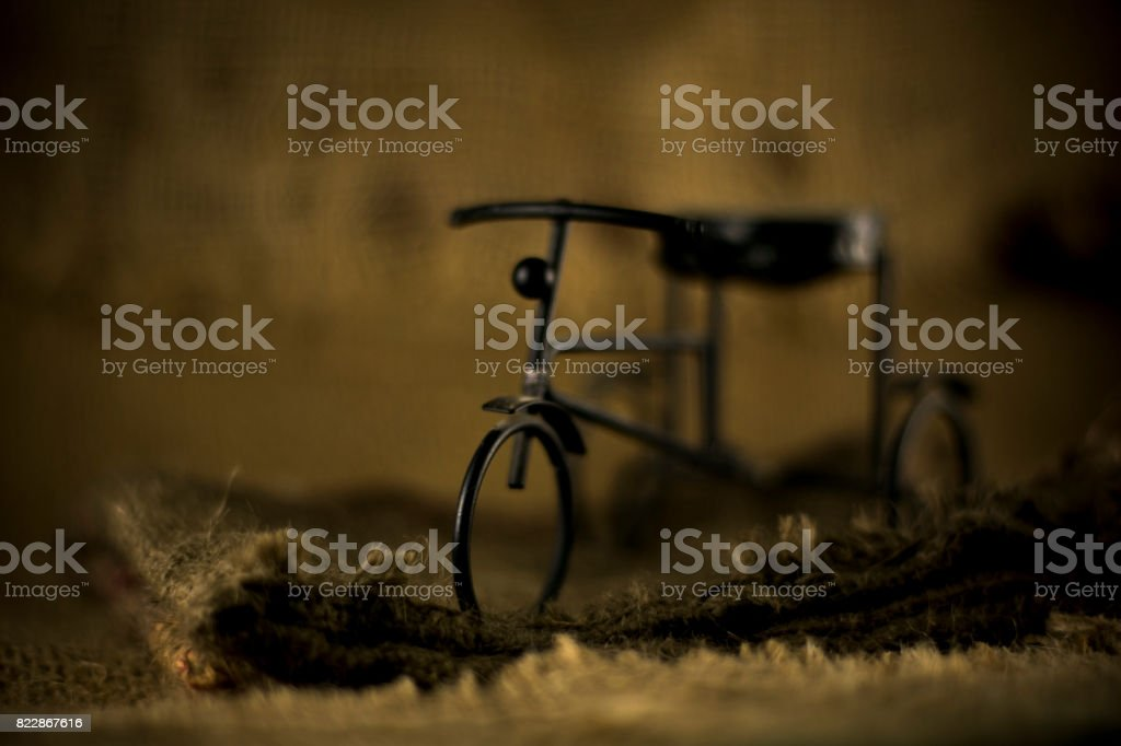 Old iron Vintage bicycle on burlap stock photo