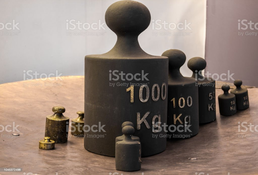 Old iron weight measurement units stock photo