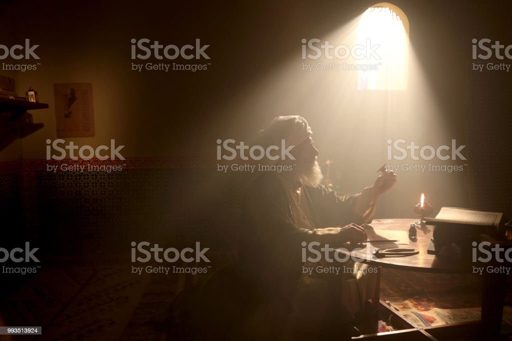 Old Islamic Scientist is Exploring a New Gear stock photo