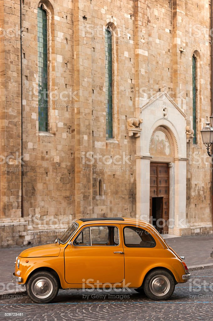 Old Italian Car in Front of a Catholic Church stock photo