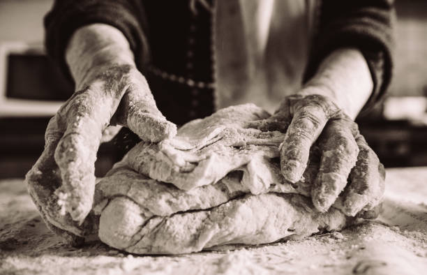 old italian  lady's hands making home made italian pasta old italian grandma making pasta in the kitchen sepia effect cooking black and white stock pictures, royalty-free photos & images