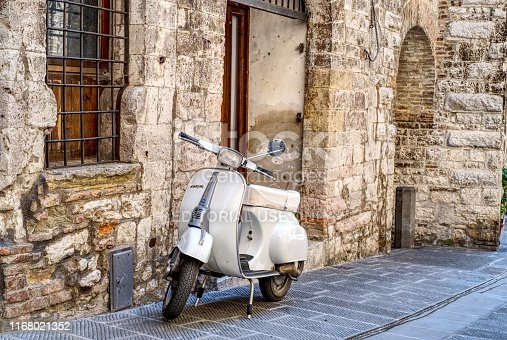 Gubbio, Italy - 11 August, 2019: Old Italian scooter parked in a street of the city of Gubbio, Umbria