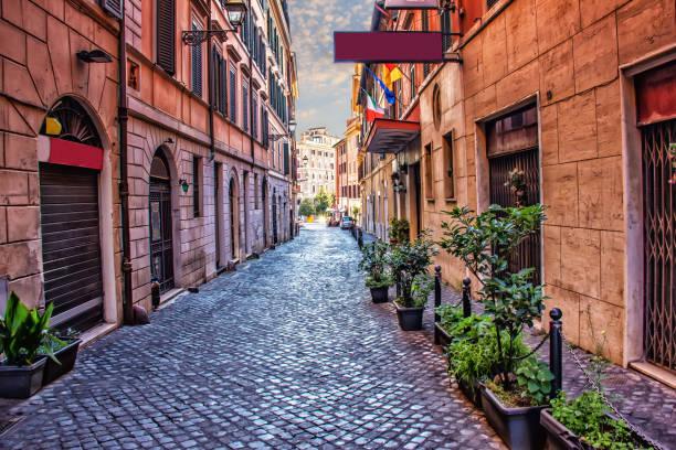 old italian street via di s. martino ai monti in rome downtown - rome road central view foto e immagini stock