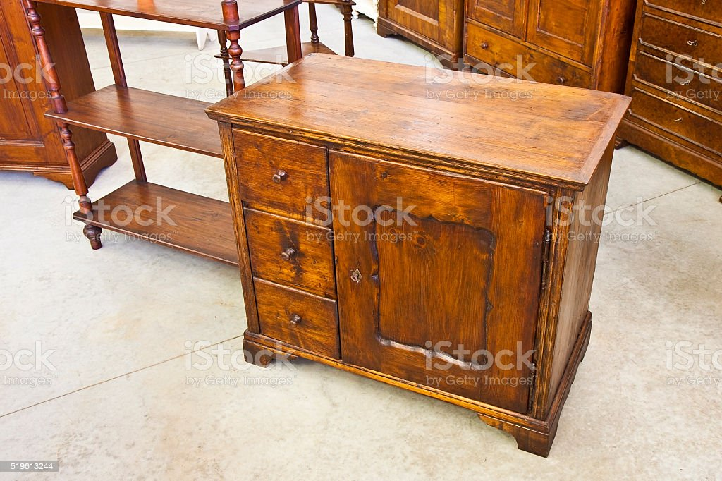 Old italian wooden dresser just restored stock photo