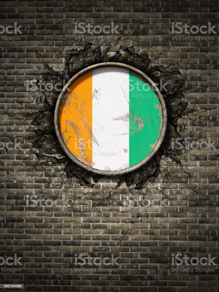 Old Ivory Coast flag in brick wall stock photo