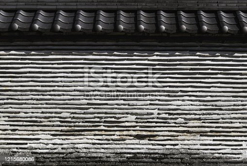 477312602 istock photo Old Japanese clay wall using roof tile 1215680086