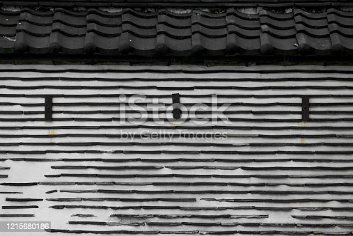 477312602 istock photo Old Japanese clay wall using roof tile 1215680186