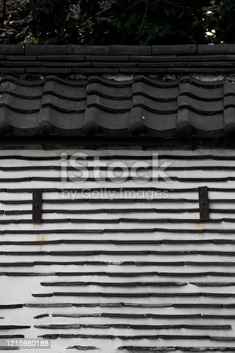 477312602 istock photo Old Japanese clay wall using roof tile 1215680188