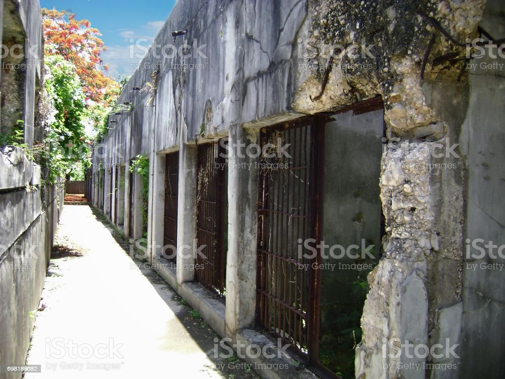 Old Japanese jail cellblocks with missing bars, Saipan stock photo