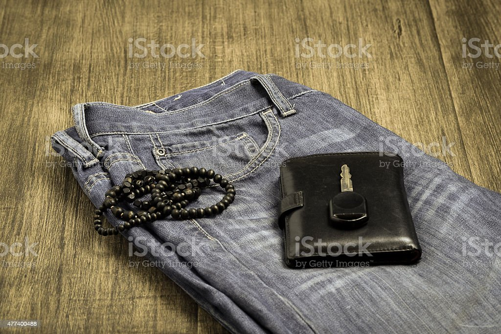 Old jeans and purse stock photo