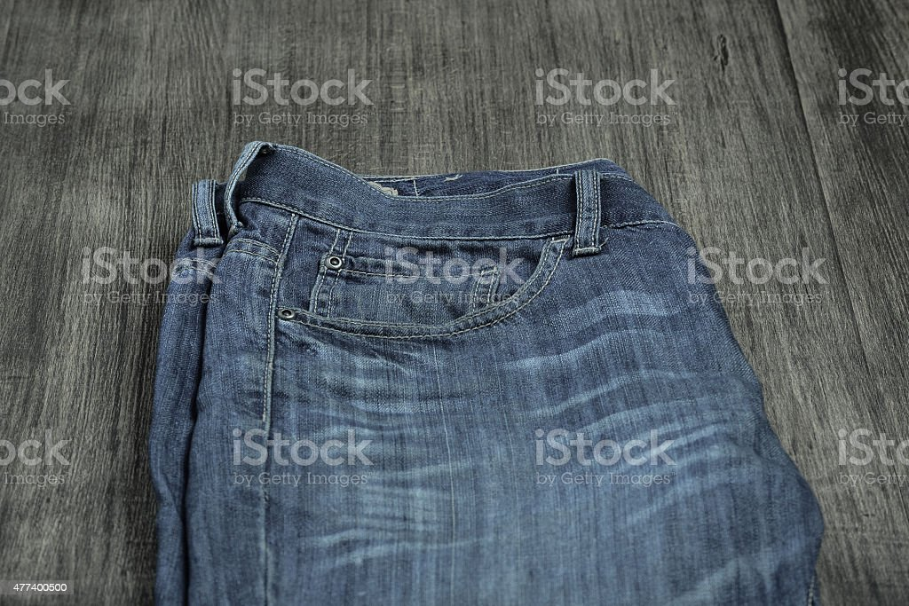 Old jeans on the old wood background stock photo