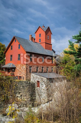 The old red mill on Brown's River in Jericho, Vermont.  Built prior to 1855 it was used as a cabinet shop and starch mill and is now the historical society headquarters and snowflake photographs museum by