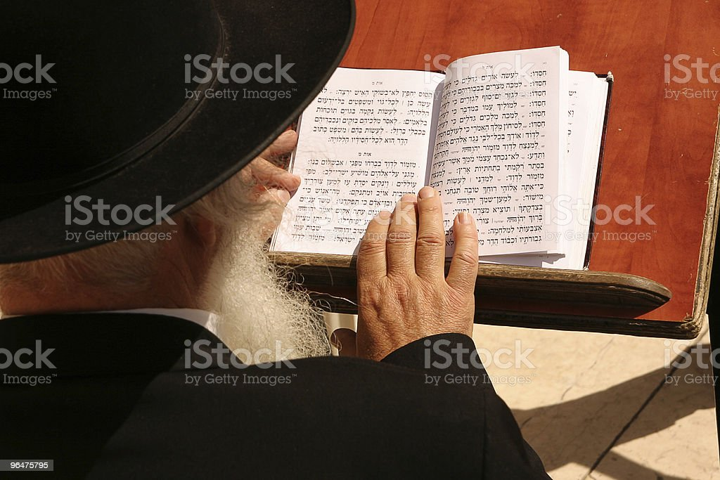 Old jew with beard reading bible at the wailing wall stock photo