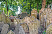 Grey crowded tombstones in the Old Jewish Cemetery in Prague