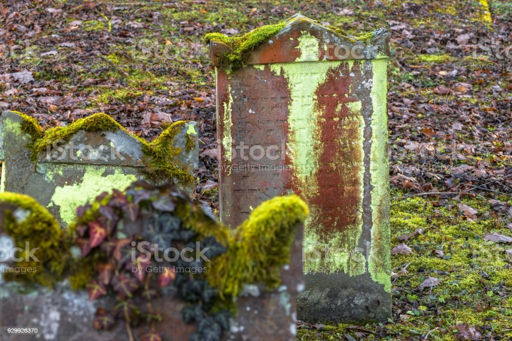 Old Jewish cemetery with weathered tombstones, Germany stock photo