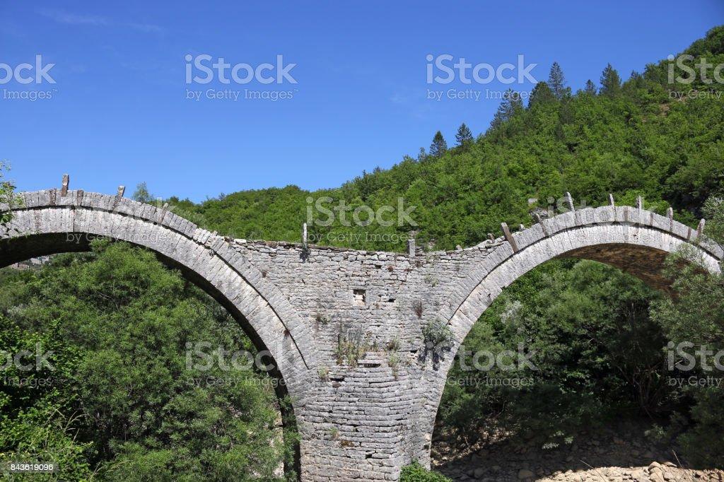 Old Kalogeriko arched stone bridge detail Zagoria Greece stock photo