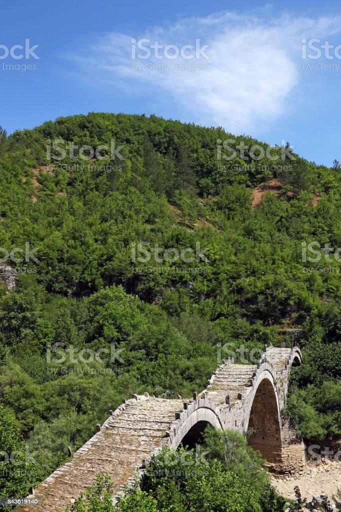 Old Kalogeriko stone bridge on Vikos gorge Zagoria Greece stock photo