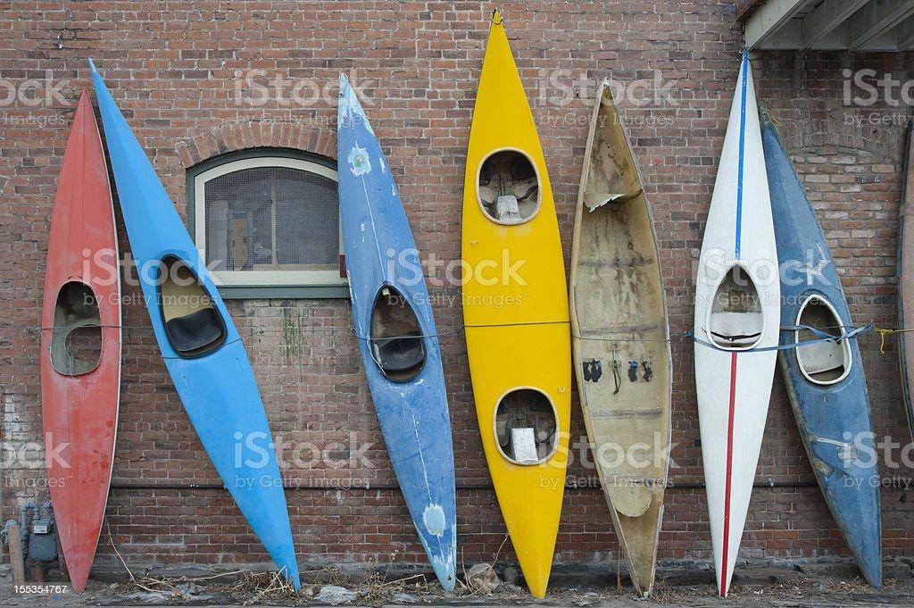 Old Kayaks on a Brick Wall royalty-free stock photo