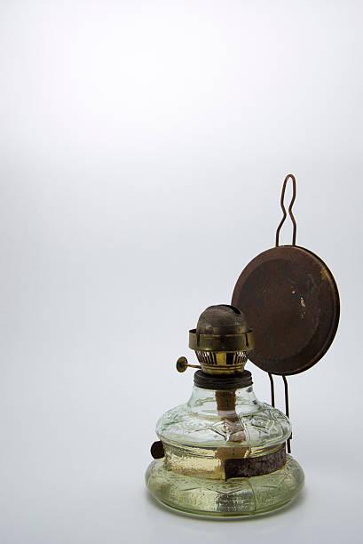 Old kerosene lamp isolated on white background stock photo