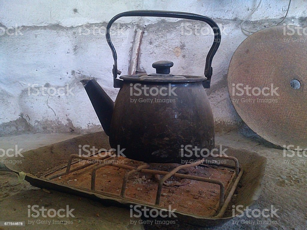 Old kettle on the burner. royalty-free stock photo